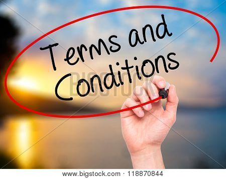 Man Hand Writing Terms And Conditions With Black Marker On Visual Screen