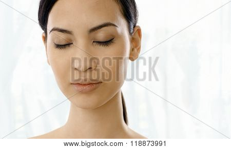 Closeup portrait of relaxing woman's face eyes closed.