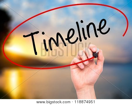 Man Hand Writing Timeline  With Black Marker On Visual Screen