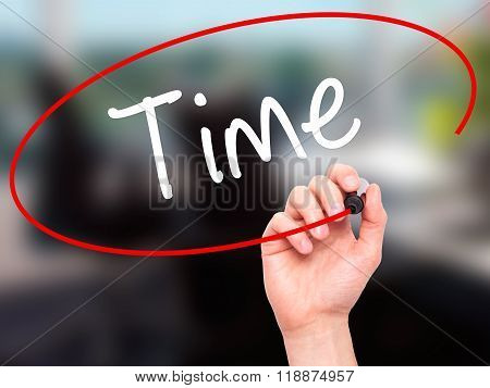 Man Hand Writing Time With Black Marker On Visual Screen