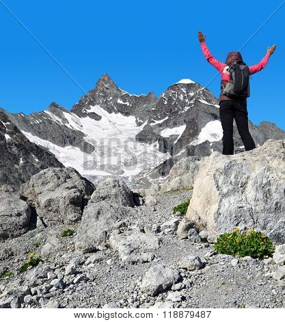 Girl on the top, in the background mount Gabelhorn - Pennine Alps, Switzerland