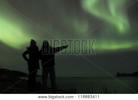 Couple braving the cold to watch the Northern lights. Tromso, Norway.