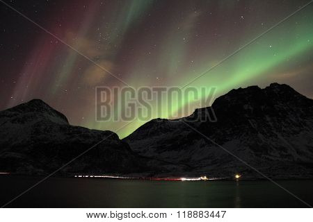 Purple and green northern lights in Tromso, Norway.