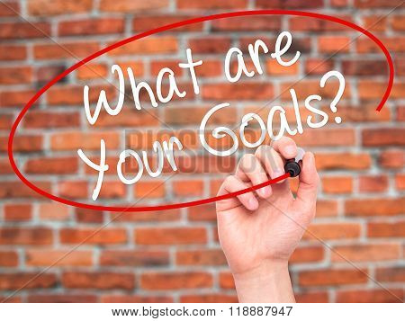 Man Hand Writing What Are Your Goals?  With Black Marker On Visual Screen