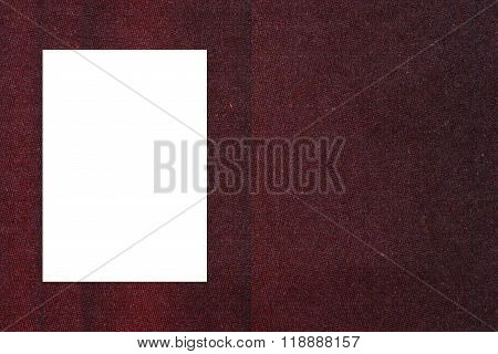 Blank folded paper poster hanging on paper taxture wall. Template mock up for adding your design.