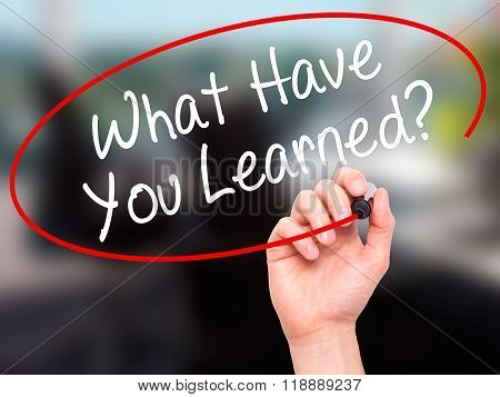 Man Hand Writing What Have You Learned? With Black Marker On Visual Screen