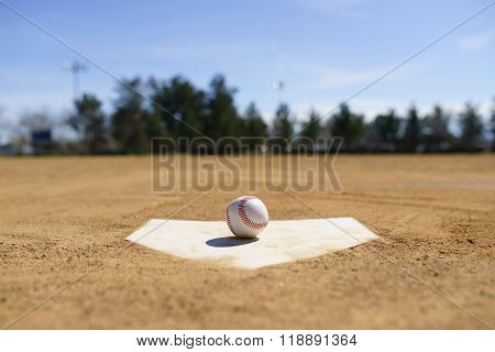 Baseball On A Home Plate In A Baseball Field In California Mountains