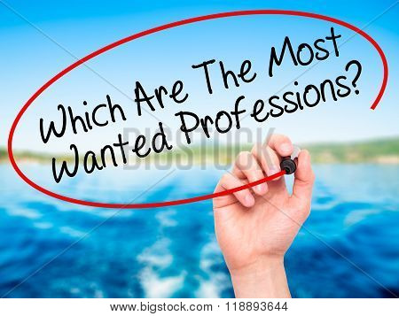 Man Hand Writing Which Are The Most Wanted Professions? With Black Marker On Visual Screen