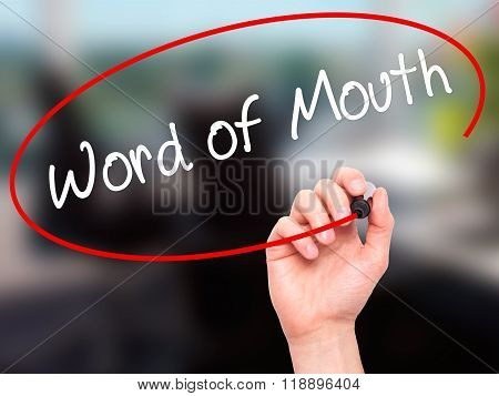 Man Hand Writing Word Of Mouth  With Black Marker On Visual Screen