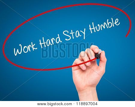 Man Hand Writing Work Hard Stay Humble  With Black Marker On Visual Screen