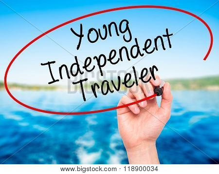 Man Hand Writing Young Independent Traveler With Black Marker On Visual Screen