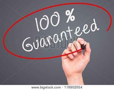 Man Hand Writing 100 Percent Guaranteed With Marker On Transparent Wipe Board