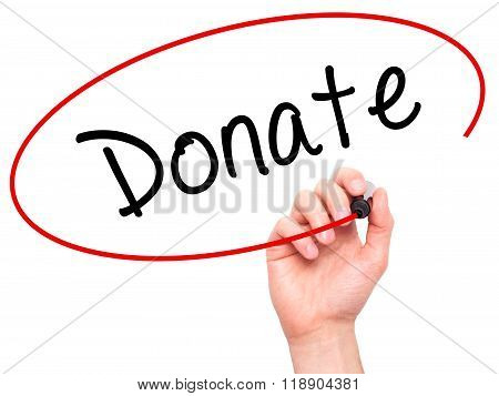 Man Hand Writing Donate With Marker On Transparent Wipe Board