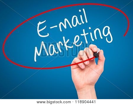 Man Hand Writing E-mail Marketing With Marker On Transparent Wipe Board Isolated On Blue
