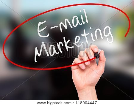 Man Hand Writing E-mail Marketing With Marker On Transparent Wipe Board Isolated On Office