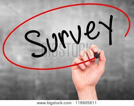 Man Hand Writing Survey With Marker On Transparent Wipe Board Isolated On Grey