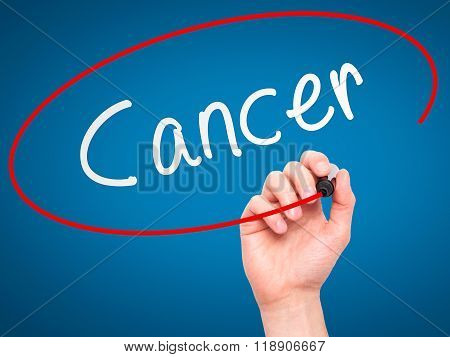 Man Hand Writing Cancer On Visual Screen