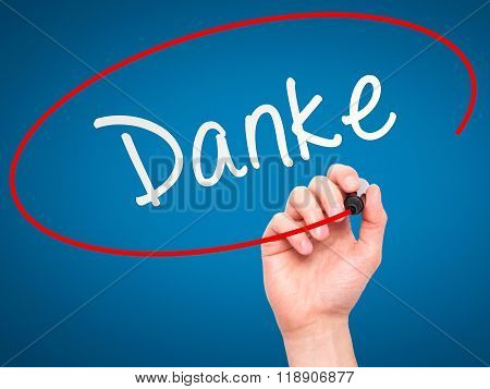 Man Hand Writing Danke With Marker On Transparent Wipe Board