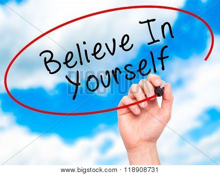 Man Hand Writing Believe In Yourself With Marker On Transparent Wipe Board