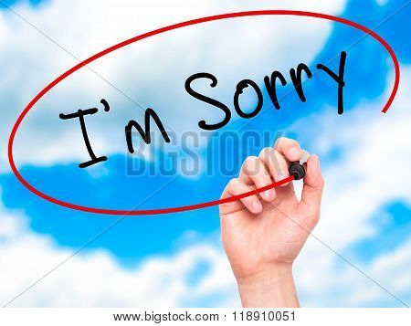 Man Hand Writing I'm Sorry With Marker On Transparent Wipe Board
