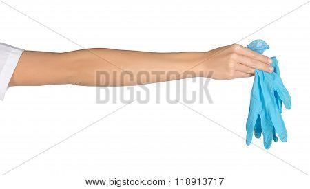 Close-up of female hand holding medical gloves