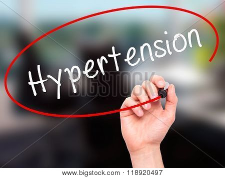 Man Hand Writing Hypertension With Black Marker On Visual Screen
