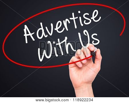 Man Hand Writing Advertise With Us  With Black Marker On Visual Screen