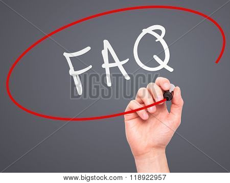 Man Hand Writing Faq - Frequently Asked Questions With Marker On Transparent Wipe Board