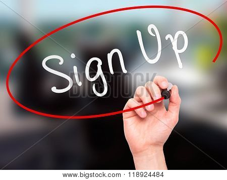 Man Hand Writing Sign Up With Marker On Transparent Wipe Board