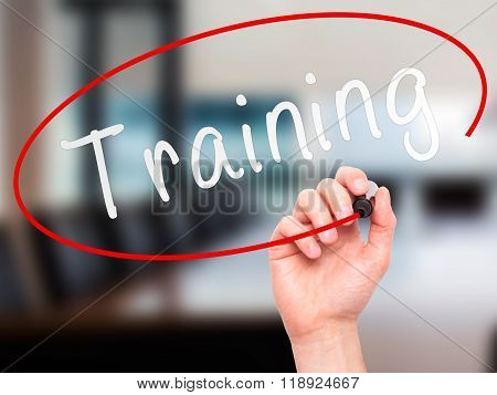 Man Hand Writing Training With Marker On Transparent Wipe Board