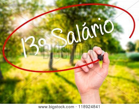 Man Hand Writing 13 Salary (13O Salario In Portuguese)  With Black Marker On Visual Screen