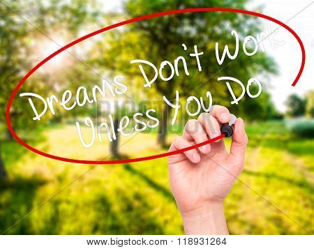 Man Hand Writing Dreams Don't Work Unless You Do  With Black Marker On Visual Screen