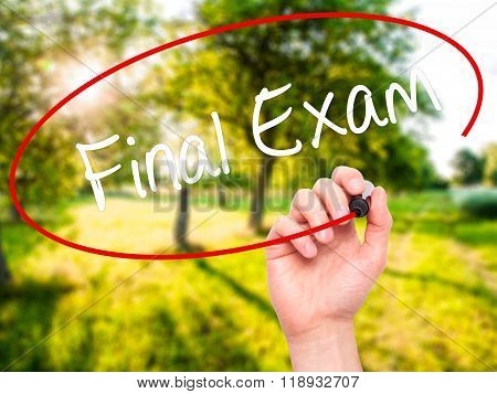 Man Hand Writing Final Exam With Black Marker On Visual Screen
