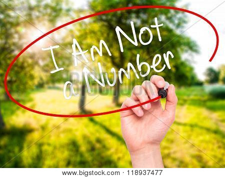 Man Hand Writing I Am Not A Number With Black Marker On Visual Screen