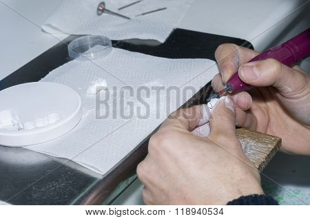 Dental Technician Using Dental Burs With Zirconium Teeth.