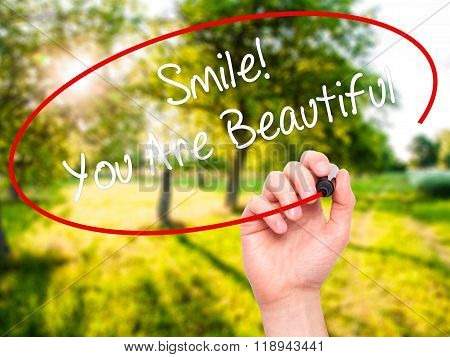 Man Hand Writing Smile! You Are Beautiful With Black Marker On Visual Screen