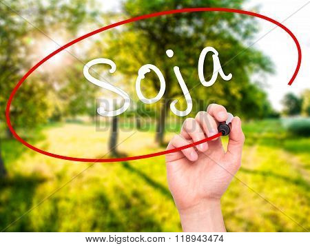 Man Hand Writing Soja (soybean In Portuguese) With Black Marker On Visual Screen