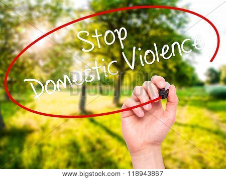 Man Hand Writing  Stop Domestic Violence With Black Marker On Visual Screen