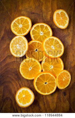 Sweet citrus slices on a wooden background