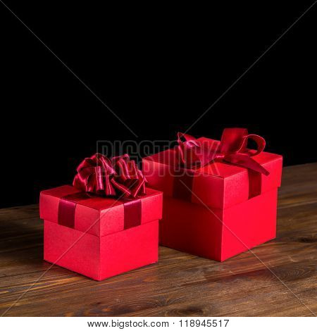 Festive Boxes With Bow On Wooden Background Is Isolated, Closeup