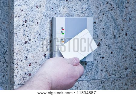 man puts the card into the reader access