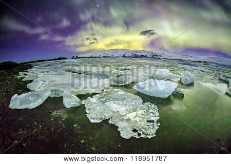 Auroral Over The Glacier Lagoon Jokulsarlon In Iceland.