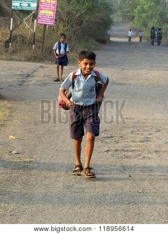 Pune, India - December 05, 2013: A Village Boy Runs Home After School Which Is Generally Miles Away