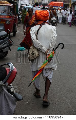 Pune, India - July 11, 2015: An Old Warkari Walking Down The Road During The Famous Wari Festival In