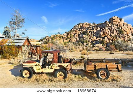 JOSHUA TREE, CALIFORNIA - JANUARY 1, 2016: Jeep and Trailer. A rusted old Jeep at Keys Ranch in Joshua Tree National Park.