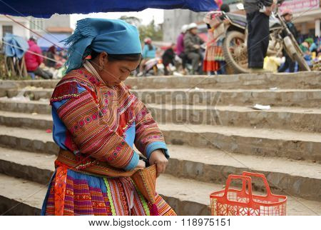 LAOCAI, VIETNAM, FEBRUARY 12, 2012: H'mong ethnic minority people in Bac Ha traditional market. H'mong is the 8th largest ethnic group in Vietnam.