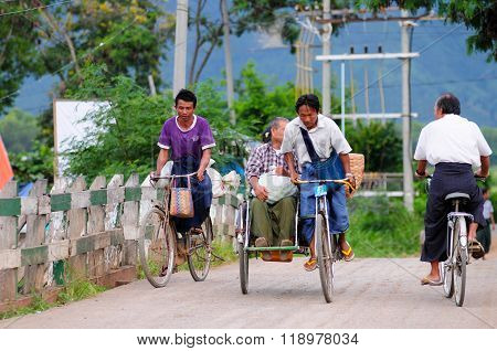 INLE, MYANMAR - SEPTEMBER 2, 2013 : A man ride trishaw in Inle, Myanmar. This is the most common method of transport that's cheap and convenient.