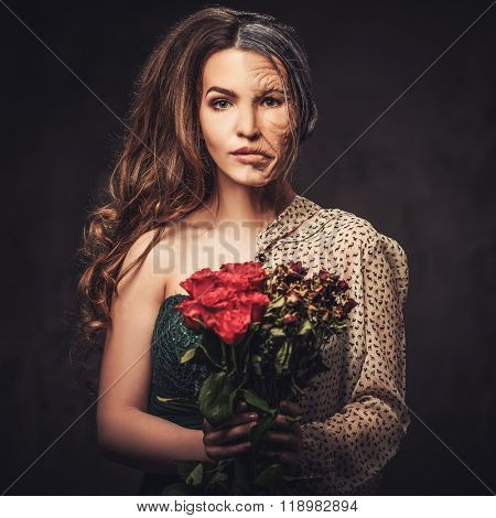 Aging and skin care concept. Half old half young woman with bouquet of red roses.