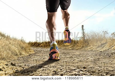 Close Up Feet With Running Shoes And Strong Athletic Legs Of Sport Man Jogging In Fitness Training W