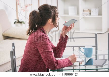Hearing impaired woman working with tablet at home or office
